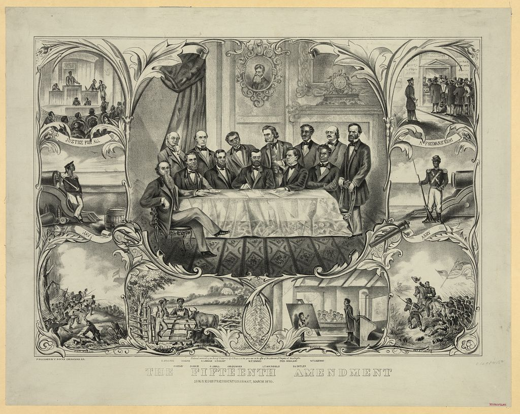 """The fifteenth amendment. Print showing President Grant sitting at the center of a large table, with several men clustered around, signing the 15th amendment granting that the right to vote cannot be denied on basis of race or color. From left, sitting and standing, are """"E. Stanton, H. Greley [i.e., Greeley], S. Colfax, A. Lincoln, R. Small[s], U.S. Grant, Chs. Sumner, W.F. Seward, Lt. Gov. Revels, Fred. Douglass, B.J. [i.e., F.] Butler, [and] W.T. Sherman."""" Vignettes along sides and bottom show African Americans in military service, at school, on the farm, and voting. A head-and-shoulders portrait of John Brown is hanging on the wall in the background."""